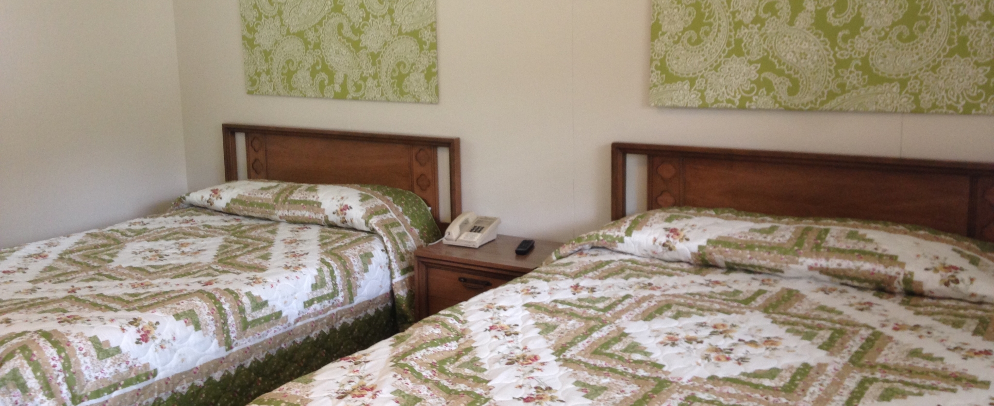 Two beds with geometric-patterned bedding